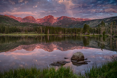 Rocky Mountain Sunrise (Bryan the Roving Vagabond) Tags: rockymountainnationalpark sunrise mountain reflection water lake pond snow trees rock sky clouds morning serene nationalpark nps tree landscape grass wood forest