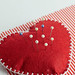 Pincushion with lot of needles and pins for sewing