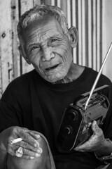 Old man listens to the radio (Angelo Daniel Prinz) Tags: bali black blackandwhite bnwgreatshots bokeh boy bwmania bwmaniac bwphotography contrast monochrome portrait porträit sanur schwarzweiss silouette porträt bw bnw
