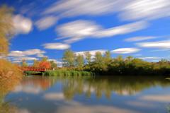 Bridge to autumn... (Daniel Q Huang) Tags: bridgge autum color folage water lake wind clouds reflection waterscape
