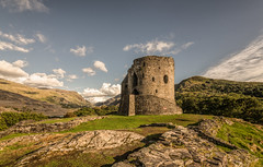 Castle on the hill (grbush) Tags: dolbadarncastle castle wales northwales snowdonia llanberrispass abandoned derelict old ancient travel sonyilce7 tokinaatx116prodxaf1116mmf28 clouds mountain rocks bluesky
