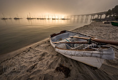 Dinghy and Bridge (mikeSF_) Tags: california san diego sandiego coronado bridge sunrise sunset beach photography mikeoria mikeoriaphotography pentax k3ii sigma 816 8mm gps dinghy boat rowboat oars sun light sand sailboat corobadobridge tidelands park landscape seascape
