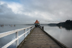 At the End of the Pier (Jocey K) Tags: newzealand nikond750 akaora bankspeninsula canterbury hills sea akaroaharbour boats scene landscape seascape sky wharf mist clouds building people yachts