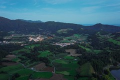 The volcanic valley of Furnas (beyondhue) Tags: furnas lagoa do view landscape azores island san miguel beyondhue travel dusk geothermal spring volcanic steam town portugal aerial viepoint ocean atlantic evening light sky