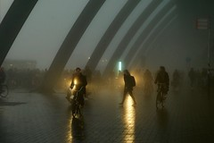 the fog (claudia 222) Tags: amsterdam 85mm zeiss central station humans mist fog dark