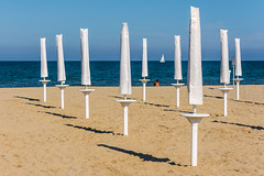 Last day of summer (deborahb0cch1) Tags: post sand beach parasol parasols beachumbrella umbrella boat sail faraway summer end endofsummer whitesail horizon white sunset light sunsetlight lastdayofsummer summerlastday lastday last