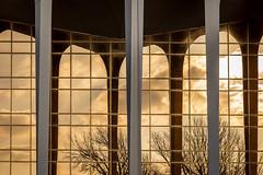 blue and gold (fallsroad) Tags: oru oralrobertsuniversity campus school architecture building columns arches windows reflection goldenhour