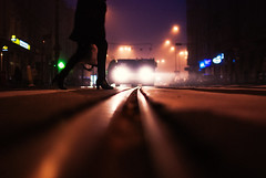 Edge of darkness (ewitsoe) Tags: archive 2017 nikond80 35mm feet legs bodyparts woman morning walking lowdof tracks tram street urban streetphotography moody atmsophere backlight streetlights early night dark foggy mist autumn fall poznan poland europe cityscape