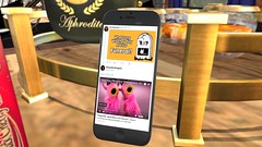 Twitter Honesty (alexandriabrangwin) Tags: alexandriabrangwin secondlife 3d cgi computer graphics virtual world photography funny silly muppets manamana pink cows keep rock alive twitter tweet reply mobile cell phone htc one x9 propped up aphrodite cognac gold tray coke can living room table funeral song inappropriate