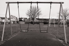 Summer's over (raymorgan4) Tags: caerphilly playground swings playing autumn trees blackandwhite canon m100 south wales rhymney empty