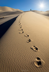 Footprints (Hilton Chen) Tags: california footprints leadinglines landscape sanddunes person sunstar scale eurekadunes deathvalleynationalpark unitedstates us