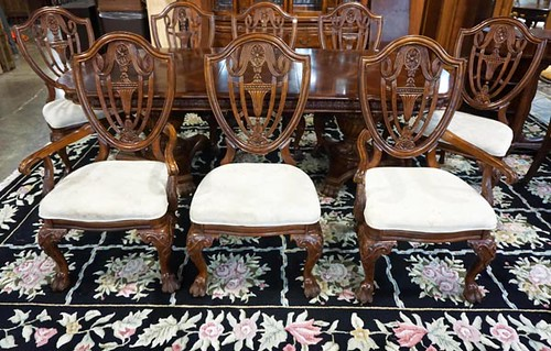 Fine Tom Seely dining room table with 2 leaves and 8 Windsor style chairs ($252.00)