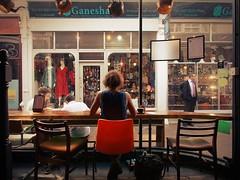 centrepiece (pix-4-2-day) Tags: woman café frau rücken back chair red rot stuhl roterstuhl window fenster schaufenster passage mall läden shops kettle kessel ganesha royalarcade cardiff