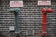 two ET (t.horak) Tags: et two pair hydro red blue street wall sign sprinkle