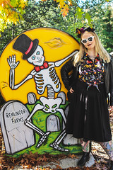 Bone Daddy (jenelle.melchior) Tags: skeleton sign painted person girl halloween october spooky farm leaves tree foliage fall autumn carnation washington remlinger