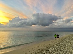 Walking into sunset (lesleydugmore) Tags: colourful beautiful colours yellow blue clouds pink sand sea ocean water coast bay lemorne mauritius people serene picturesque magical majestic