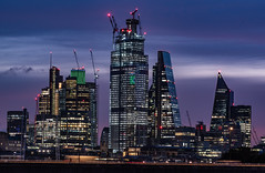 Emerald City... (Aleem Yousaf) Tags: heron tower tower42 natwest 22 bishpsgate gherkin cheesegrater scalpel modern buildings new dawn emerald city cityscape skyline lloyds london windows lights glass steel cranes construction shadows reflections sky sunrise blue hour clouds waterloo hungerford bridge traffic nikkor 200500mm skyscraper londonist londoner ambient digital camer world flickr vantage frame commercial composition fun long exposure photography walk purple magenta building architecture