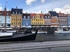 Historic Nyhavn in Copenhagen, Denmkark (` Toshio ') Tags: toshio nyhavn copenhagen denmark europe danish scandinavia restaurants buildings architecture boat ship harbor european europeanunion scandinavian cloud iphone