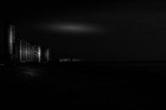 Spooky night in Flushings (The Dutch Crow) Tags: netherlands vlissingen night sea seaside dark spooky sky light bw black white noir nacht nuit nero blanco beach river