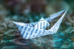 295/365: Let your dreams set sail... (judi may) Tags: 365the2018edition 3652018 day295365 22oct18 october2018amonthin31pictures macromonday macromondays macro crinkledwrinkledfoldedorcreased origami paper boat paperboat origamiboat print paperfolding frommycraftstash papercrafting canon5d bokeh dof depthoffield