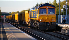 GBRf Class 66/7 no 66778 at Ilkeston Station on the evening of 27-09-2018 (kevaruka) Tags: ilkeston derbyshire station evening twilight trains train transport autumn september 2018 colour colours color colors flickr thephotographyblog front page telephoto dof depth bokeh england class 66 60 43 canon eos 5d mk3 70200 f28 is mk2 5d3 5diii red yellow 60011 tree railroad sky locomotive