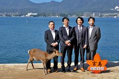 Japan: Miyajima, four men and a deer (Henk Binnendijk) Tags: hatsukaichi hiroshima miyajima japan people deer animal men island insel eiland hert ree