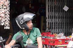 Checking For Traffic (Shane Hebzynski) Tags: thailand helmet bangkok person man driver