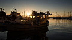Sunset and a fishing boat (Wilco1954) Tags: france sunflare stillness sunset fishingboat toulon leicaq