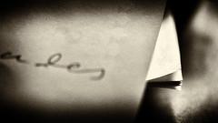scrawl (Francis Mansell) Tags: paper writing macro monochrome blackwhite niksilverefexpro2 sepia filmgrain abstract