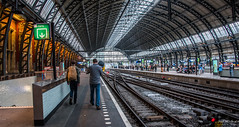 2018 - Amsterdam - Amsterdam Centraal (Ted's photos - For Me & You) Tags: 2018 cropped delft nikon nikond750 nikonfx tedmcgrath tedsphotos vignetting trainstation traintracks tracks train trainhall backpack station