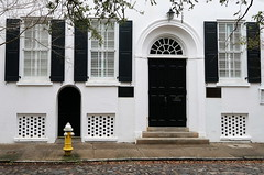 The Bible Depository (1828), now home to the German Friendly Society, 29 Chalmers Street, Charleston, SC (Spencer Means) Tags: dwwg door doorway arch window shutters facade street chalmers cobblestone charleston sc southcarolina bible depository germanfriendlysociety black