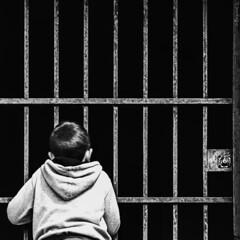 facing fear (*BegoñaCL) Tags: boy child blackwhite bars lock begoñacl darkness