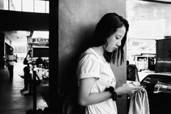 Caution (Meljoe San Diego) Tags: meljoesandiego fuji fujifilm x100f streetphotography people smartphone candid monochrome philippines