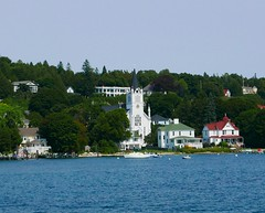 church from the lake (ekelly80) Tags: michigan mackinacisland august2018 summer upnorth puremichigan view lake water lakehuron church stanne houses shore boats