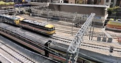 Approaching Wemblesden Park. (ManOfYorkshire) Tags: wemblesdenpark oogauge 176 scale layout model railway train trains class87 electric overhead wires busy doubleheader locomotion shildon show exhibition 2018 display onshow exhibit