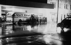 Greyhound, 1948 (clarkfred33) Tags: greyhound greyhoundhistory vintage vintagephoto historic historicphoto lakeland lakelandhistory bus greyhoundlines rain wet weather 1948 street wetstreet nightphoto timeexposure