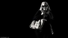 A woman of great contrast. (Neil. Moralee) Tags: neilmoralee neilmoraleenikond7200 woma girl lady contrast blond blonde dark black white bw bandw monochrome mono bag glasses hair bright sunshine candid harsh neil moralee nikon d7200 noir film fashion blackandwhite high highcontrast branscombe devon uk england smile face portrait