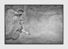 Man in Profile Smoking (Christina's World Off and On) Tags: portrait blackandwhite bw monochrome grunge border dramatic textures realpeople candid streetcandidportrait california sandiego coronado unitedstates composition negativespace smoke smoker smoking exoticimage