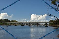 Burnett River (Dreaming of the Sea) Tags: sliderssunday bluesky clouds bundaberg burnettriver bridge gumtree nikond7200 tamronsp2470mmf28divcusd gimp water boats trainbridge railbridge queensland australia streetlights hss