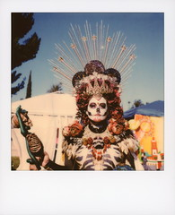 Muertos Maiden 3 (tobysx70) Tags: polaroid originals color sx70 instant film sx70sonar sonar maiden dia de los muertos celebration hollywood forever cemetery santa monica blvd boulevard angeles la california ca woman lady portrait skull makeup flower crown headdress star skeleton necklace costume bokeh blue sky palm tree route rte rt 66 toby hancock photography