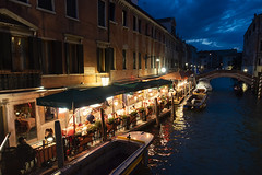 Canal side bistro (ORIONSM) Tags: canal venice restaurant bistro food night water reflection blue hour italy sony rx100mk3