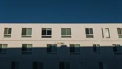 (emmeffess) Tags: minimalistic minimal window shadow sun light blue sky white apartment livingspace building architecture