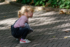 First Take A Rest (Alfred Grupstra) Tags: child outdoors people oneperson boys blondhair childhood cute lifestyles fun street small cheerful preschoolage happiness sitting casualclothing girls toddler