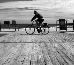 Boardwalk (Dalliance with Light (Andy Farmer)) Tags: jersey beach ocean monochrome boardwalk asburypark nj bicycle bw water sand shore newjersey unitedstates us mitakon35mmf095