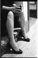 SusannahMichaelWedding_331 (Johnny Martyr) Tags: legs wine drink drinking woman girl shoes heels bw knees calves sitting open alcohol fingers hands detail feminine lady dress film 35mm grain ilfrod ilford 3200 6400 kodak hc110 contrast nikon nikkor f2