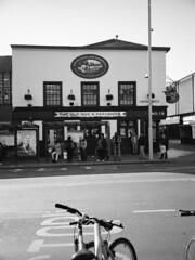 The old dog and partridge. (Esmik D'Aguiar) Tags: nottingham uk british pub bus stop bike parliament street partridge mono fujifilm ga645zi 120 medium format neopan 400