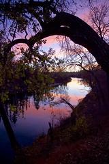 Natural Frame Elbow River (John Andersen (JPAndersen images)) Tags: alberta bowriver bridge calgary city colour day evening fall night pond skyline sunset trees