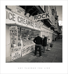 Any flavour you like (Parallax Corporation) Tags: southport blackwhite candid seasidetown monochrome sonya7rii zeissbatisfe18mmf28 tourists rock icecream wideangle