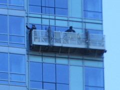 2018 Window Washers Cleaning Apartment Tower 3904 (Brechtbug) Tags: 2018 window washers cleaning glass apartment building tower from hells kitchen clinton near times square broadway nyc 10292018 city midtown manhattan spring springtime weather dark low hanging cumulonimbus cumulus nimbus cloud hell s nemo southern view ny1 windows washer scaffold rig platform off buildings clean october