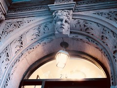 Wind Blown Gargoyle Face Above Doorway 4814 (Brechtbug) Tags: wind blown gargoyle face above doorway building facade 25th street between 7th 8th avenues brownstone entrance nyc 11122018 new york city midtown manhattan 2018 gargoyles portraits monster portrait monsters creature faces spooky art architecture sculpture keystone mask brownstones brown stone